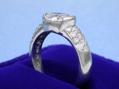 Half Bezel Set Oval Diamond Engagement Ring with Three Rows of Pave on Shank