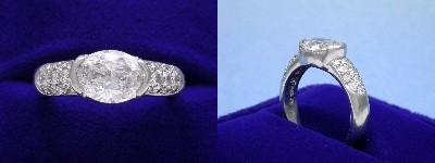 Oval Diamond Ring: 1.54 carat with 1.35 ratio in 0.50 tcw Pave and Half Bezel mounting