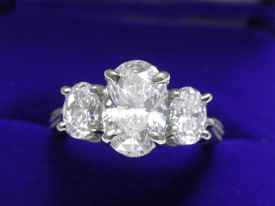 Oval Cut Diamond Ring: 1.59 carat with 0.87 tcw Oval diamonds