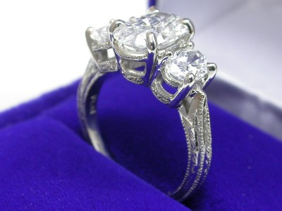 Oval Cut Diamond Ring: 1.59 carat with 0.87 tcw Oval diamonds and Hand Carved Shank