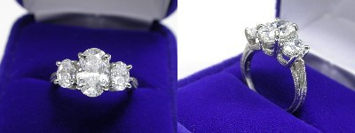 Oval Diamond Ring: 1.59 carat with 1.54 ratio in 0.87 tcw Oval Cut diamond three-stone mounting