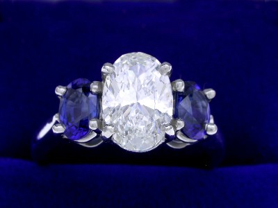 Oval Cut Diamond Ring: 1.70 carat 1.70 ratio with Oval Sapphires