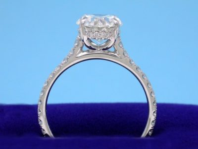 French-set pave diamonds on underbezel and going three-fourths the way down the shank