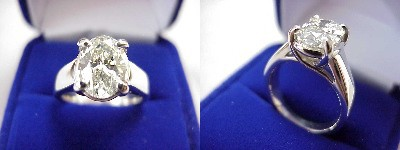 Oval Diamond Ring: 2.01 carat with 1.40 ratio in four-prong Trellis style mounting