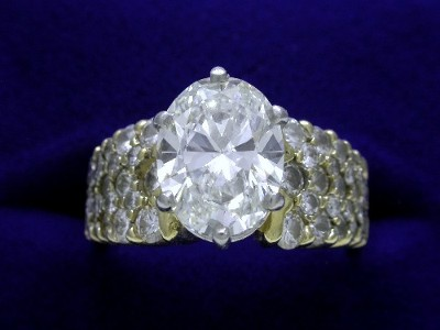 Oval Cut Diamond RIng: 2.03 carat with 1.29 ratio in 1.11 tcw pave Yellow Gold Mounting