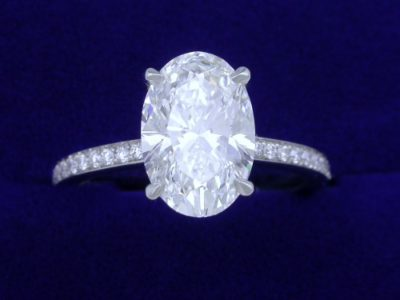 Oval Cut Diamond Ring: 2.21 carat with 1.48 ratio and 0.29 tcw pave diamonds
