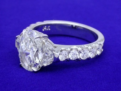 Oval Cut Diamond Ring: 2.28 carat with 0.65 tcw Crescent Moon and 0.71 tcw Pave Mounting