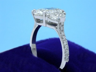 Oval Cut Diamond Ring: 2.61 carat with 1.41 ratio in 0.90 tcw Crescent Moon 3-stone mounting