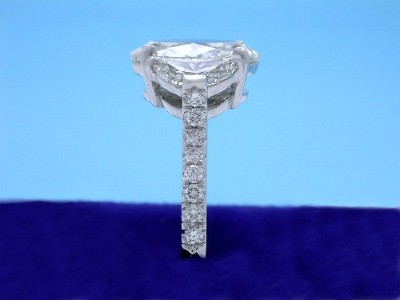 16 round pave-set diamonds with a 0.21 total carat weight going half way down the 2.1 mm wide shank