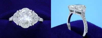 Oval Diamond Ring: 2.61 carat with 1.41 ratio in 0.90 tcw Crescent Moon Cut diamond three-stone mounting