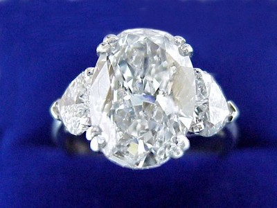 Oval Cut Diamond Ring: 3.02 carat with 1.43 ratio and 0.98 tcw Heart Shaped Diamonds