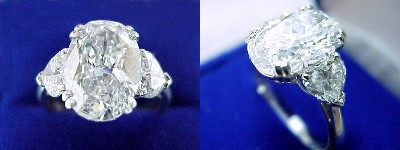 Oval Diamond Ring: 3.02 carat with 1.43 ratio in 0.98 tcw Heart Shaped diamond three-stone mounting