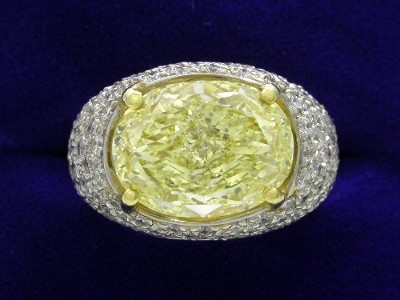 Oval Cut Diamond Ring: 5.62 carat Fancy Light Yellow with 1.32 ratio in Pave-Set mounting