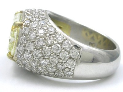 custom platinum and yellow gold mounting with round pave diamonds
