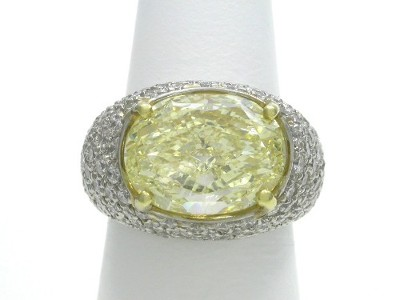 Fancy Light Yellow Oval Cut Diamond Engagement Ring