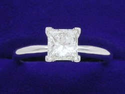 1.01 carat Princess Cut diamond ring with H color, SI1 clarity in 14-karat white-gold Solitaire style mounting.