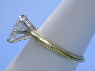 Pear shaped diamond prong-set in 14-karat gold mounting with white-gold 6-prong head and yellow-gold shank