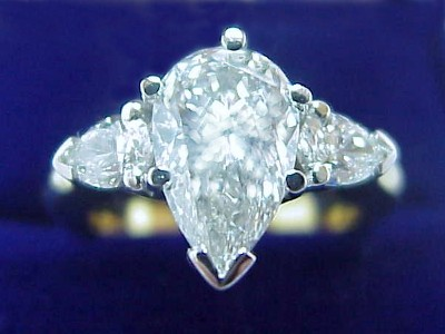 Pear Cut Diamond Ring: 1.40 carat with 1.61 ratio with 0.40 tcw Pear Diamonds