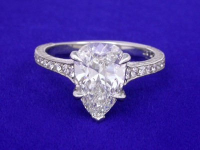 Pear Cut Diamond Ring with Graduated Pave Shank