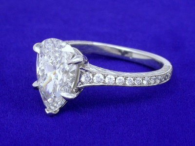 Pear Cut Diamond Engagement Ring with Pave and Hand Carved Shank