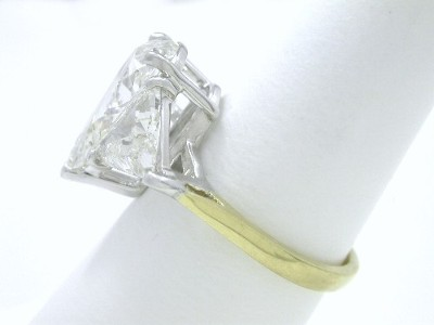 Pear and Crescent Trillion cut diamond ring with custom two-tone 18-karat yellow gold and platinum mounting