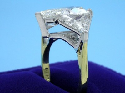 Pear Cut Diamond Ring: 4.21 carat with 1.54 ratio and 2.02 tcw Crescent Trillion Diamonds