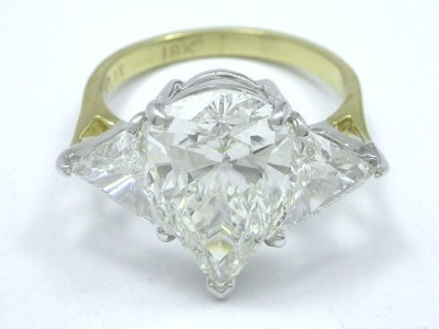 Three Stone Diamond Ring with Pear and Crescent Triangular Cut Diamonds