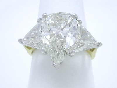 Pear and Crescent Triangular cut diamond engagement ring