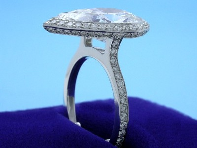 Pear Cut Diamond Ring: 5.27 carat with 1.45 ratio in 0.70 tcw Pave Halo and Shank Mounting
