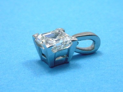 Asscher cut diamond pendant with platinum four-prong custom basket style mounting and a single bail