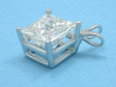 Princess cut diamond pendant with four prong basket mounting and double bail