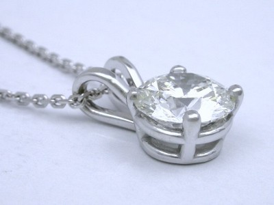 Round brilliant cut diamond pendant with four prong basket and double bail