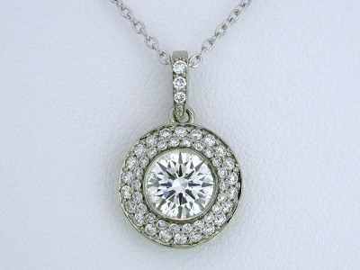 Round brilliant cut diamond Bez Ambar designer pendant with bezel set round diamond surrounded by double row of pave and pave on the bail