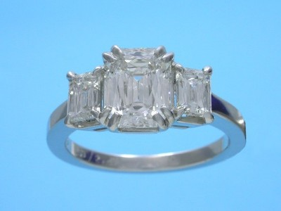 PrinceCut three-stone diamond engagement ring with 14-karat white-gold mounting with basket-style heads