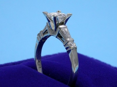 Princess Cut Diamond Ring: 0.46 carat with 0.18 tcw Tapered Baguettes and 0.07 Round Diamonds