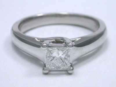 Diamond ring with 0.50 carat square modified (Princess) cut diamond graded E color, VS1 clarity