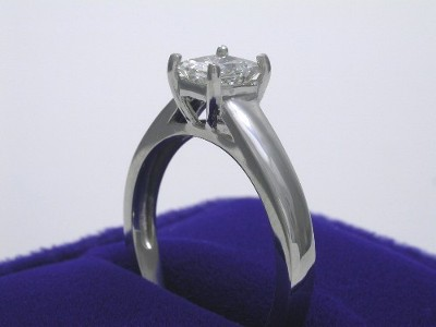 Princess Cut Diamond Ring: 0.68 carat in Basket Head and Cathedral Shank mounting