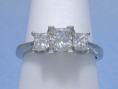 Princess Cut Diamond Ring: 0.70 carat Three Stone with 0.68 tcw Side Princess Diamonds