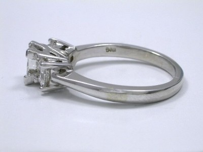 Three-stone princess cut diamond engagement ring with 14-karat white-gold mounting