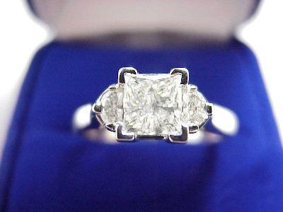 Princess Cut Diamond Ring: 0.71 carat with 0.19 tcw Half Moon Diamonds