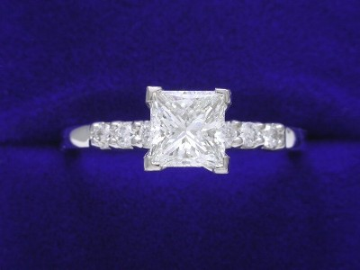 Princess Cut Diamond Ring: 1.00 carat in 0.18 tcw Bead-Set Round Diamond Mounting