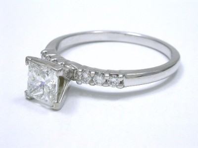 Princess cut diamond ring with 14-karat white-gold mounting with four-prong 4-prong style head and six round brilliant cut bead-set diamonds