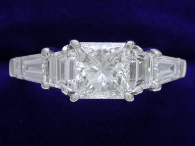 Princess Cut Diamond Ring: 1.01 carat with 0.48 tcw Trapezoids and 0.57 tcw Tapered Baguettes