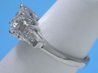 Princess cut diamond engagement ring with trapezoids and tapered baguettes