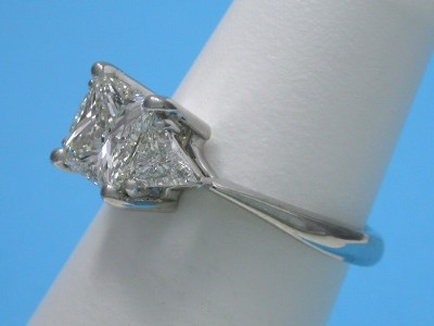 Princess Cut Diamond Ring: 1.15 carat with 0.32 tcw Trillion Side Diamonds