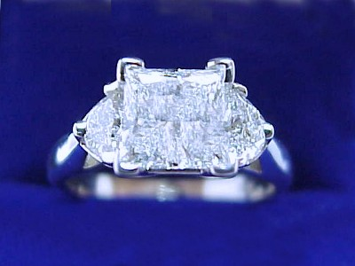 Princess Cut Diamond Ring: 1.15 carat with 0.41 tcw Half Moon Diamonds