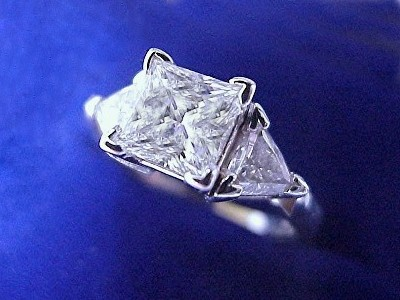 Princess Cut Diamond Ring: 1.21 carat with 0.52 tcw Trillion Diamonds