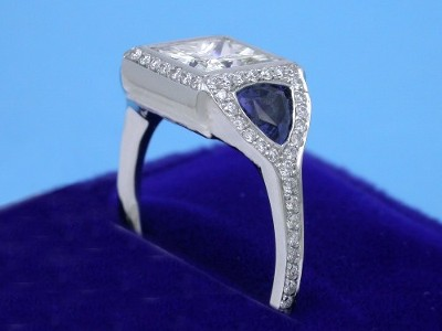 Princess Cut Diamond Ring: 1.58 carat with 0.81 tcw Blue Sapphire Trillions and 0.37 tcw Pave Mounting