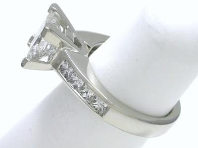 Princess cut diamond ring with custom platinum Leo Ingwer designer mounting featuring eight channel-set square modified brilliant (Princess) cut diamonds