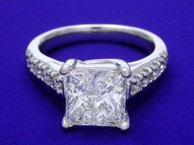 Princess Cut Diamond Ring: 2.01 carat with 0.24 tcw Round Diamonds